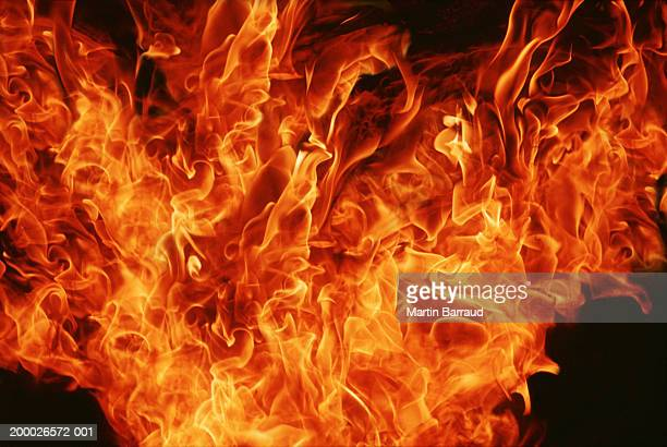 flames against black background, full frame - fire natural phenomenon stock pictures, royalty-free photos & images