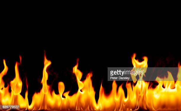 flames against black background - flame stock pictures, royalty-free photos & images