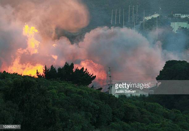 Flames and a smoke plume rise from a massive fire in a residential neighborhood September 9 2010 in San Bruno California A huge explosion rocked a...