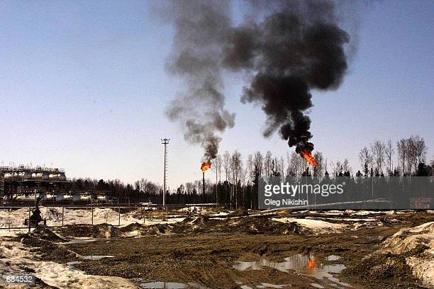 Flames and black smoke from burning petroleum are shown April 24 2002 in Nefteyugansk Siberia Yukos is a fully integrated oilandgas company...