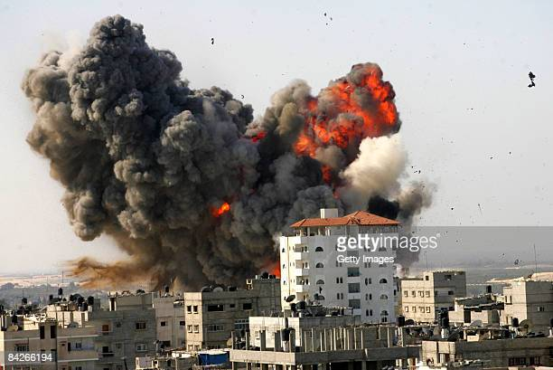 Flames and debris rise following an Israeli air strike on January 13 2009 in Rafah Gaza Strip Israel is intensifying its widescale ground assault...