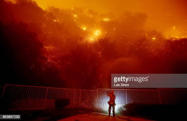 Flames and embers swirl around a firefighter battling the Canyon Fire on September 25 2017 in Corona California The fire charred about 1500 acres by...
