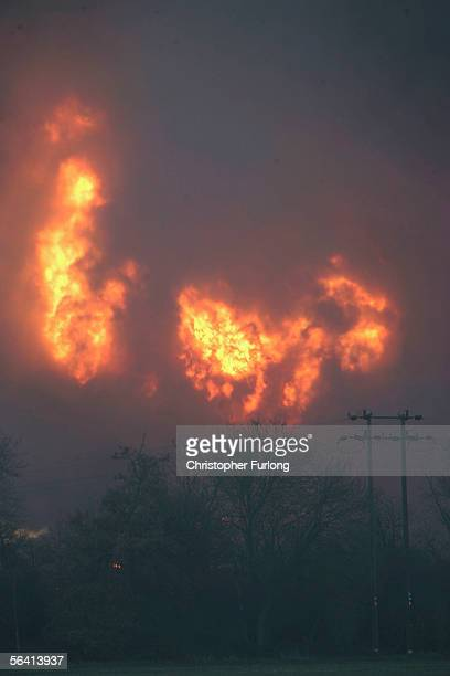 Flames and plumes of smoke rise following a series of explosions at Bruncefield oil depot on December 11 2005 in Hemel Hempstead EnglandThe...