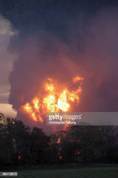 Flames and plumes of smoke rise from Bruncefield oil depot on December 11 2005 in Hemel Hempstead EnglandThe explosions are being treated as...
