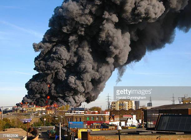Flames and plumes of thick black smoke rise from a fire in the vicinity of Waterden Road Hackney Wick on November 12 2007 in London England The...