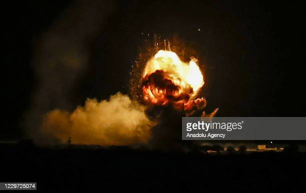 Flames and smoke are seen after an Israeli air strike hit Hamas targets in Khan Yunis, Gaza on November 22, 2020.