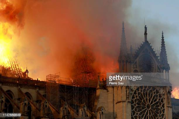 Flames and smoke are seen billowing from the roof at Notre-Dame Cathedral April 15, 2019 in Paris, France. A fire broke out on Monday afternoon and...