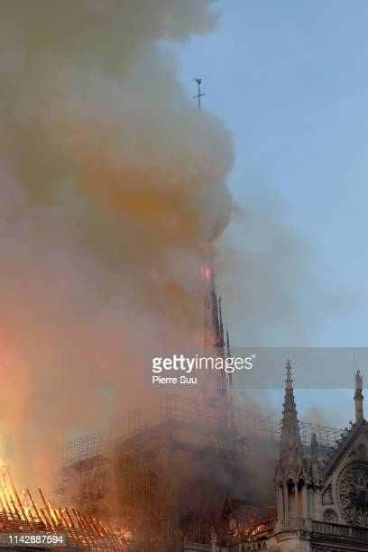 Flames and smoke are seen billowing from the roof at NotreDame Cathedral April 15 2019 in Paris France A fire broke out on Monday afternoon and...