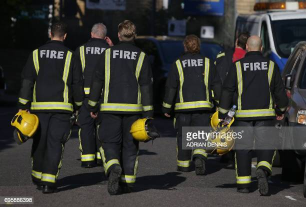 Flames and smoke engulf Grenfell Tower a residential block of flats in west London on June 14 as firefighters continue to control a fire that started...