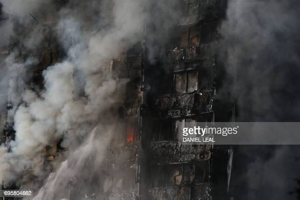 TOPSHOT Flames and smoke engulf Grenfell Tower a residential block on June 14 2017 in west London The massive fire ripped through the 27storey...