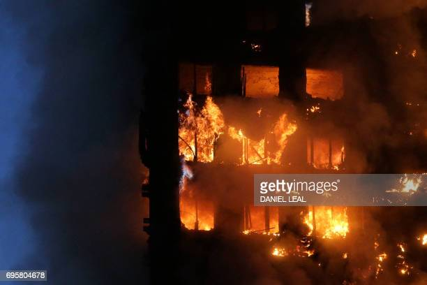 Flames and smoke engulf Grenfell Tower a residential block on June 14 2017 in west London The massive fire ripped through the 27storey apartment...