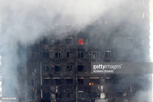 Flames and smoke engulf Grenfell Tower a residential block on June 14 2017 in west London Shaken survivors of a blaze that ravaged a west London...