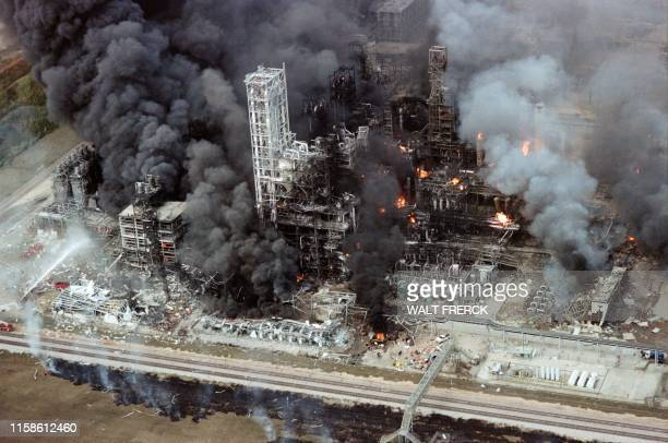 Flames and smoke pour from the Phillips 66 Chemical Plant Houston on October 23 1989 after a noon exploion caused extensive damage and injuries The...