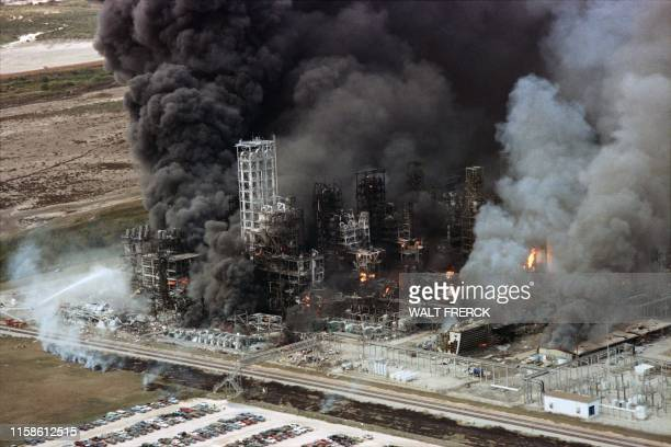 Flames and smoke pour from the Phillips 66 Chemical Plant Houston on October 23, 1989 after a noon exploion caused extensive damage and injuries. -...