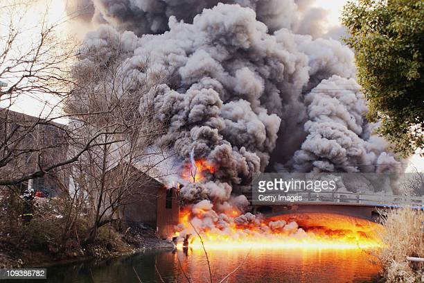 Flames and smoke rise after an explosion at a chemical plant on February 23 2011 in Wuxi China According to local media authorities the cause of the...