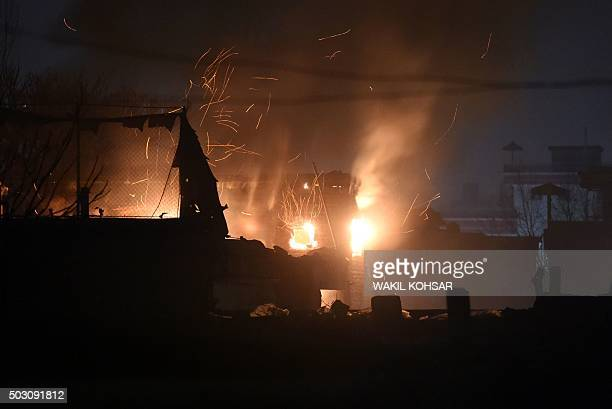 Flames and smoke rise at the site of a suicide car bomb attack at a French restaurant Le Jardin in Kabul on January 1 2016 A Taliban suicide car...