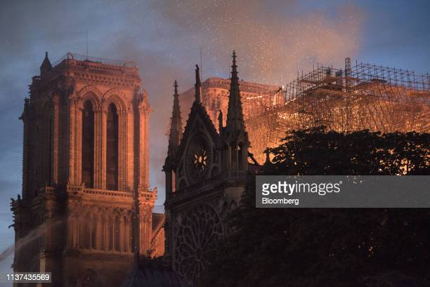 Flames and smoke rise from a fire at Notre-Dame Cathedral in Paris, France, on Monday, April 15, 2019. A massive fire is ripping through the...