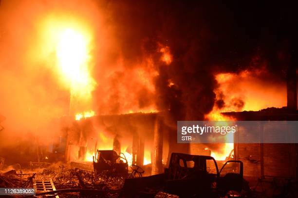 Flames and smoke rise from building after a fire broke out in an old part of the Bangladeshi capital Dhaka on February 21 2019 At least 69 people...
