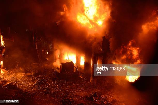 TOPSHOT Flames and smoke rise from building after a fire broke out in an old part of the Bangladeshi capital Dhaka on February 21 2019 At least 69...