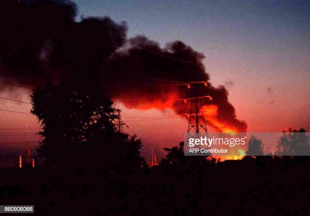 Flames and smoke rise from the electric power plant in Belgrade's suburb Bezanijska Kosa 28 May 1999 after the plant was hit by a NATO missile late...