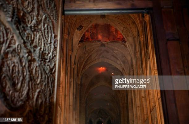 Flames and smoke rise from the interior of NotreDame Cathedral in Paris on April 15 after a fire engulfed the building A huge fire swept through the...