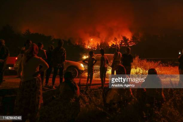 Flames and smoke rising after a fire that broke out in Izmir province of Aegean Turkey on August 19 2019 Fire brigade crew continue their works...