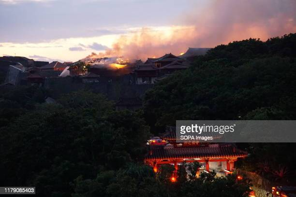 Flames and smoke seen coming from the Shurijo castle a UNESCO World Heritage site in Okinawa Fire broke out around midnight and burned down the main...