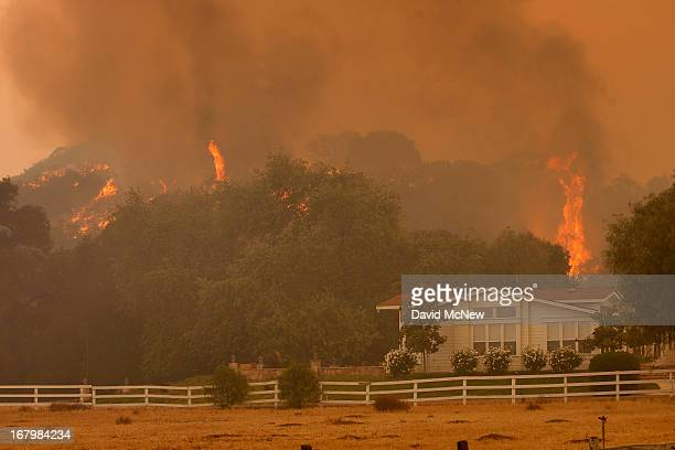 Flames approach the Blackiston Ranch as the Springs fire continues to grow on May 3 2013 near Camarillo California The wildfire has spread to more...