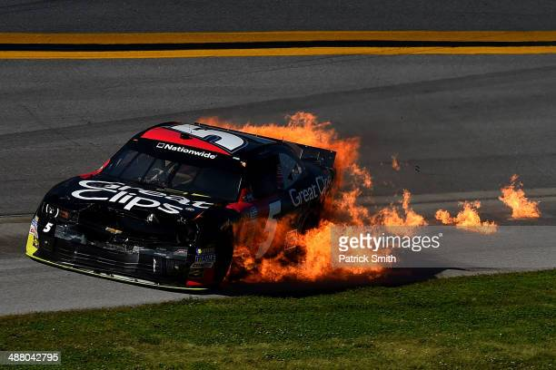 Flames are seen from the car of Kasey Kahne driver of the Great Clips Chevrolet during the NASCAR Nationwide Series Aaron's 312 at Talladega...