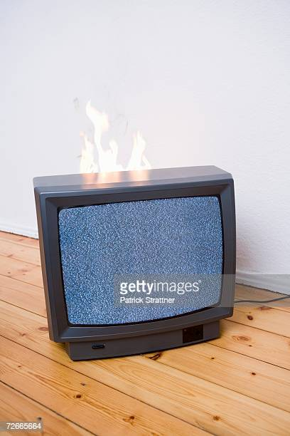 Flames behind television