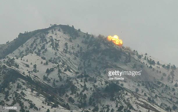 Flames billow from the top of a mountain after air strikes on a suspected enemy position by United States Airforce B52 bombers March 10 2002 near the...