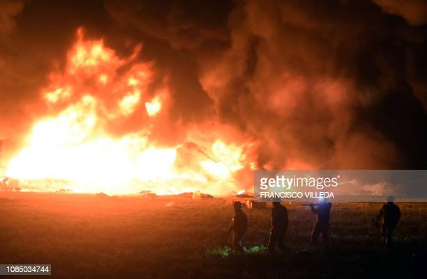 TOPSHOT Flames burn at the scene of a massive blaze trigerred by a leaky pipeline in Tlahuelilpan Hidalgo state on January 18 2019 An explosion and...