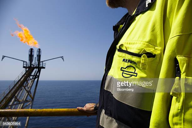 Flames burn from gas venting pipes on the Casablanca oil platform operated by Repsol SA in the Mediterranean Sea off the coast of Tarragona Spain on...
