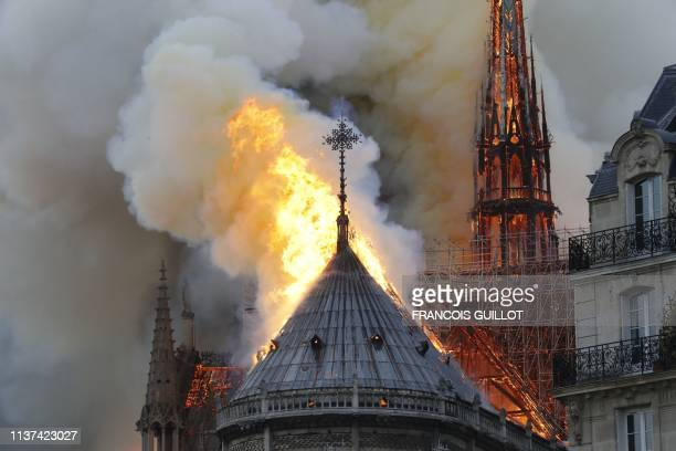 Flames burn the roof of the landmark NotreDame Cathedral in central Paris on April 15 potentially involving renovation works being carried out at the...