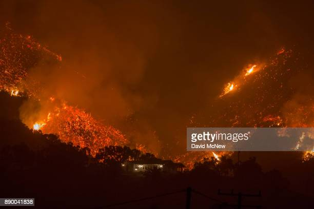Flames come close to a house as the Thomas Fire advances toward Santa Barbara County seaside communities on December 10 2017 in Carpinteria...