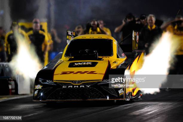 Flames come from the JR Todd Toyota Camry NHRA Funny Car during qualifying for the NHRA AAA Midwest Nationals on September 21 at Gateway Motorsports...