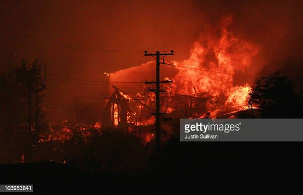 Flames consume homes during a massive fire in a residential neighborhood September 9 2010 in San Bruno California A huge explosion rocked a...