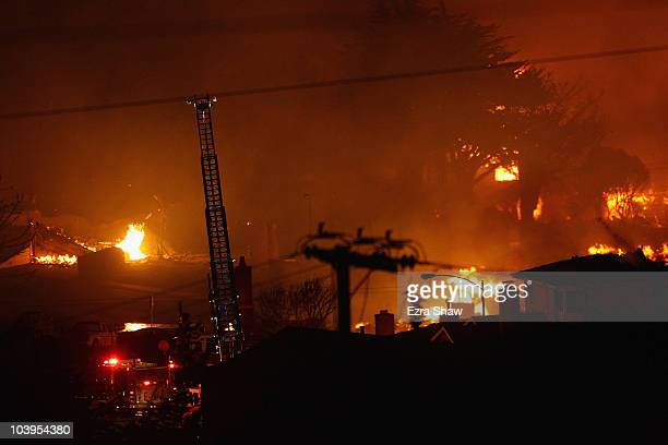 Flames consume homes during a massive fire in a residential neighborhood September 9 2010 in San Bruno California A massive gas line explosion likely...