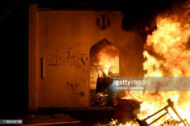 Flames consume Iran's consulate in the southern Iraqi Shiite holy city of Najaf on November 27 two months into the country's most serious social...
