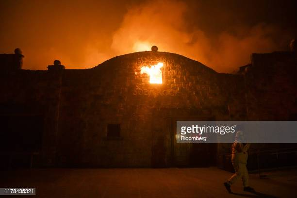 Flames engulf a burning building at the Soda Rock Vineyards during the Kincade fire in Healdsburg California US on Sunday Oct 27 2019 The wildfire...