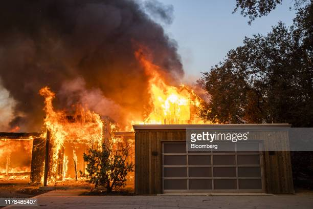 Flames engulf a home as it burns along Highway 128 during the Kincade fire in Healdsburg California US on Sunday Oct 27 2019 The wildfire that...