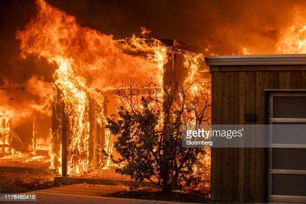 A home along Highway 128 burns during the Kincade Fire in Healdsburg California US on Sunday October 27 2019 Photographer Philip Pacheco/Bloomberg...