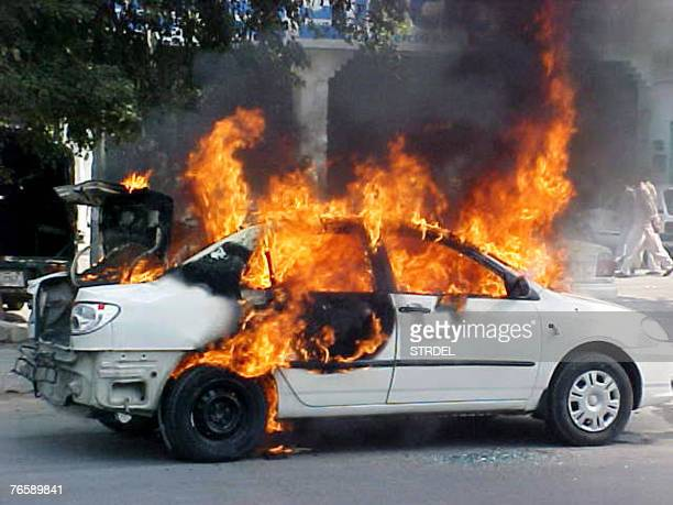 Flames erupt from a burning car after a bomb explosion in a car park area of Peshawar 08 September 2007 A car bomb exploded in a parking area at a...