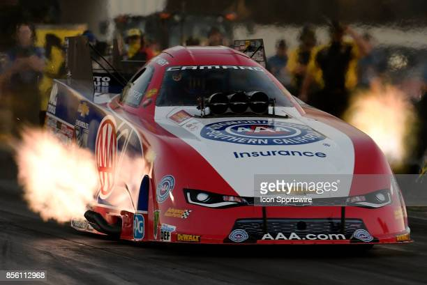 Flames erupt from the exhaust of the Robert Hight John Force Racing Chevrolet Camaro SS NHRA Funny Car during qualifying for the 6th annual AAA...