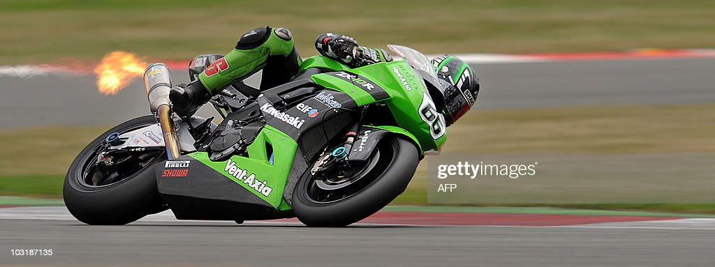Flames exit the exhaust pipe of Britain's Tom Sykes during