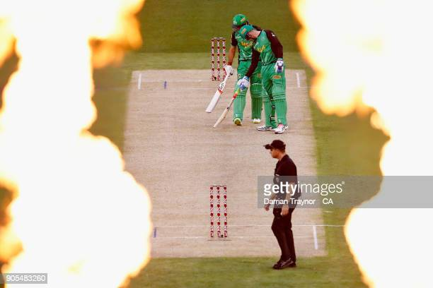 Flames fly into the air after Glenn Maxwell of the Melbourne Stars hits a six during the Big Bash League match between the Melbourne Stars and the...