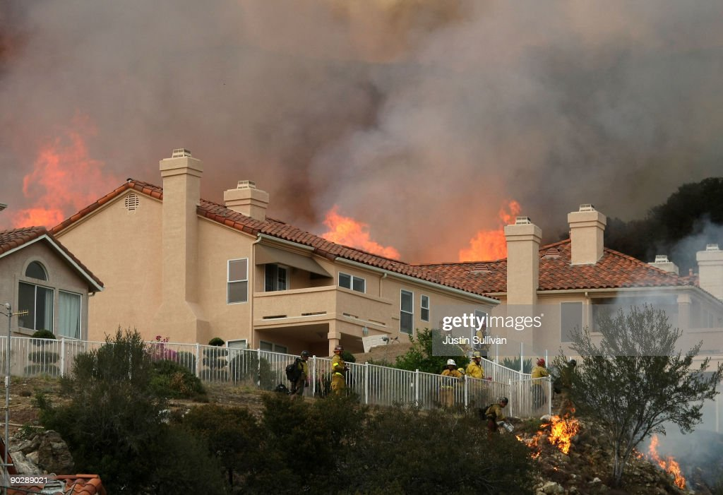 Flames from a backfire approach homes September 1, 2009 in