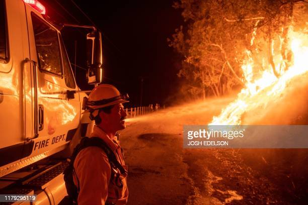 Flames from a backfire burn during the Maria fire in Santa Paula California on November 1 2019