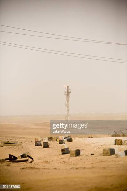 flames from a burn-off tower, desert outside of cairo, egypt - jake warga fotografías e imágenes de stock
