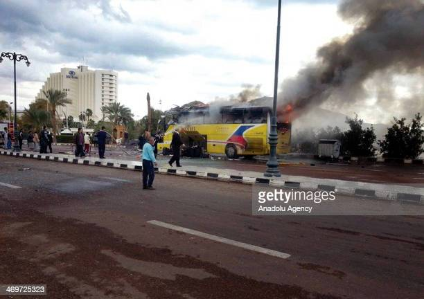 Flames from a tourist bus attacked in the Sinai Peninsula of Egypt on February 16 2014 At least 3 people were killed and 14 others got injured in the...